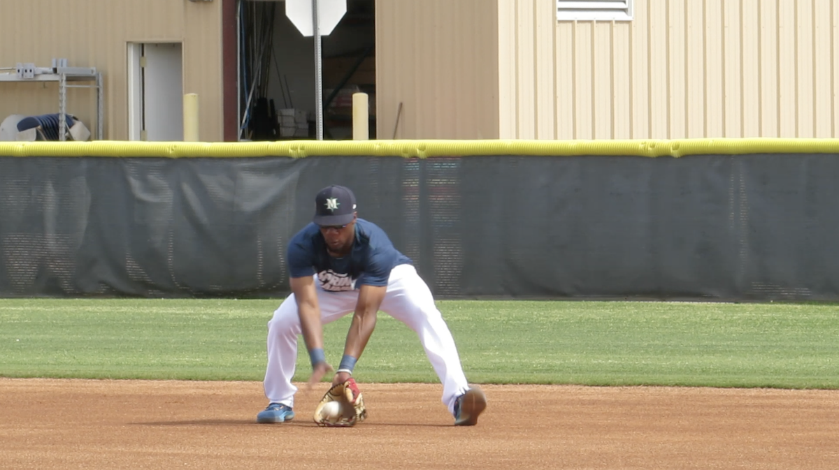 Shed Long Jr fielding ground ball at spring training